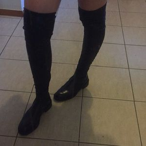 Thought high black leather boots